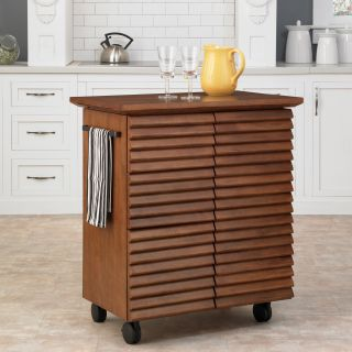 Cascade Louvred Kitchen Cart (ChestnutMaterials: Hardwood solids and veneersFinish: Warm oak Dimensions: 36.25 inches high x 32 inches wide x 20.5 inches deepNumber of shelves: One (1) Number of drawers/compartments: Three (3) Model: 5454 95Assembly requi