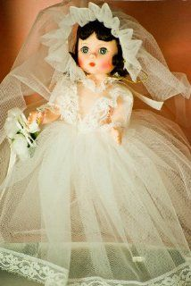 Madame Alexander   #435   Bride Doll   8 Inches   Brown Hair / Gray Sleepy Eyes   White Tulle Wedding Dress w/ Lace Trim   Floral Bouquet w/ Ribbon   Veil Cap   Lace V Bodice   Lace Trimmed Bloomers   Flowered Garter   White Shoes   Out of Production   Lik