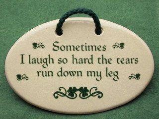 Sometimes I laugh so hard the tears run down my leg. Mountain Meadows Pottery ceramic plaques and wall art signs with funny sayings and quotes about laughter, aging, and peeing in your pants, or wetting your pants when sneezing, with an Irish decoration. M